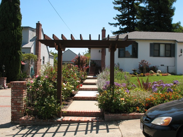 A welcoming Arbor frames this entrance